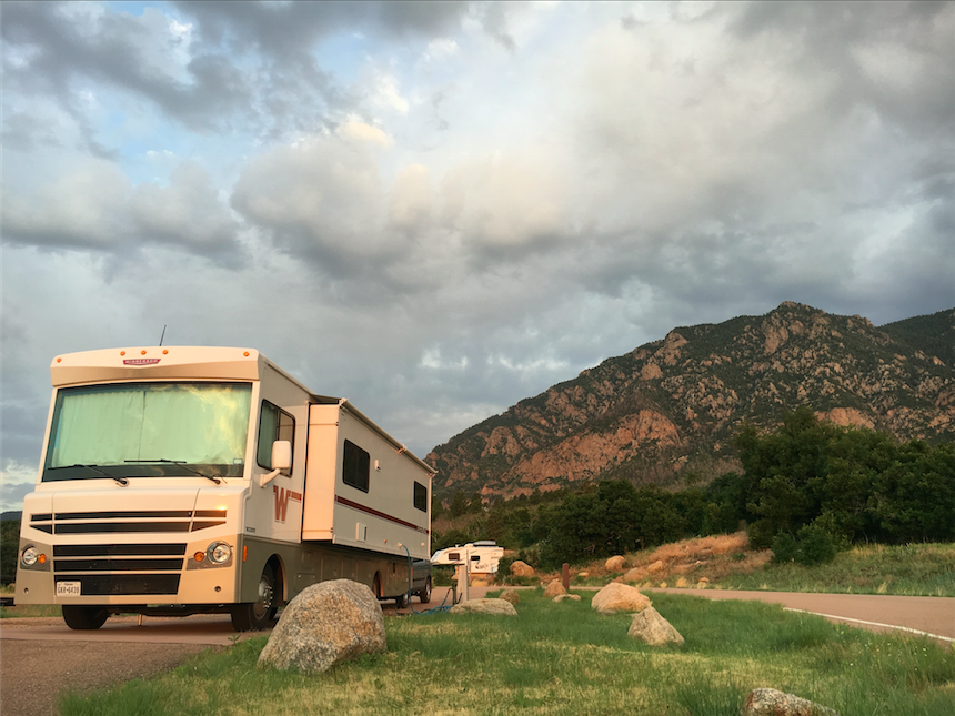 2016 Winnebago Brave parked in front of Cheyenne Mountain State Park