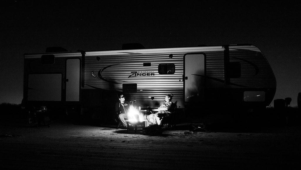 A campfire at night roasting smores