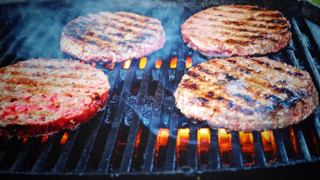 Hamburgers on Grill | Outdoorsy RV Rental Marketplace
