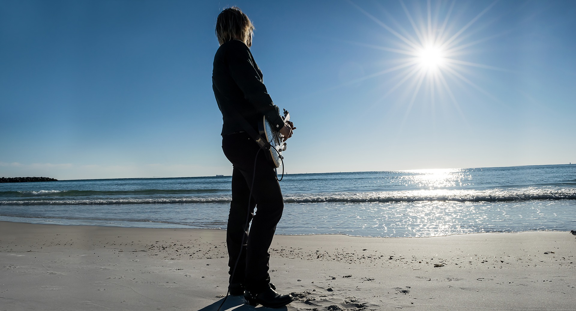 Pixabay guitarist on the beach | Outdoorsy RV Rental Marketplace