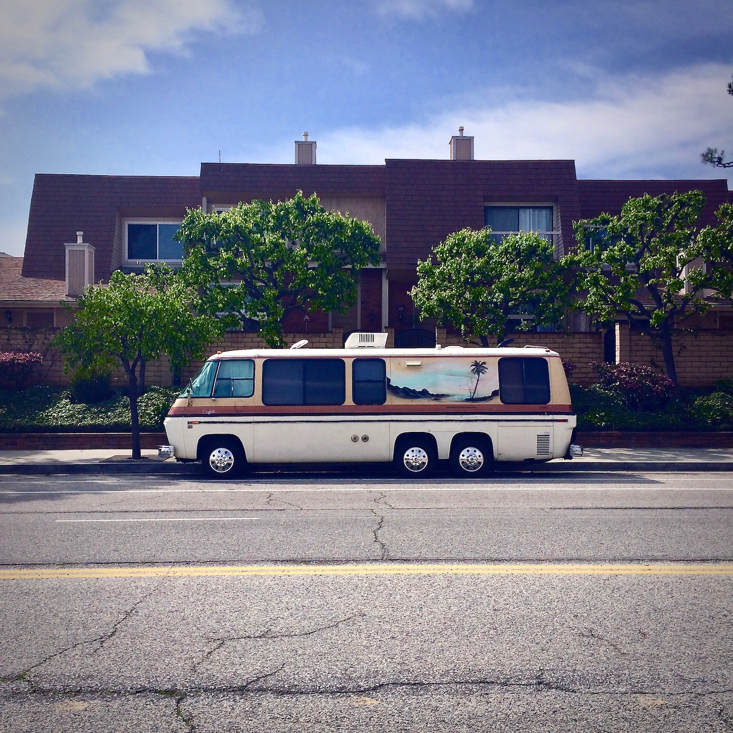 RV in a parking lot   Outdoorsy RV Rental Marketplace