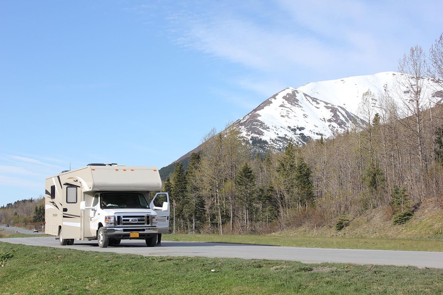 rv getting ready to drive next to snowy mountain