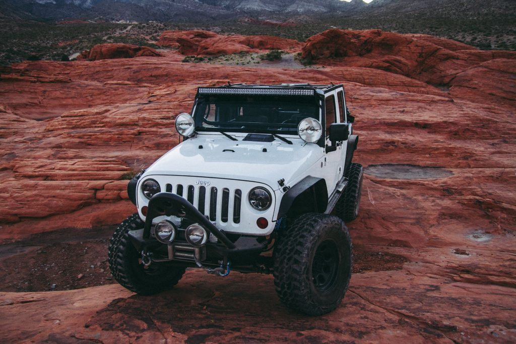Jeep on red rocks Rebelle Rally I Outdoorsy RV Rental Marketplace
