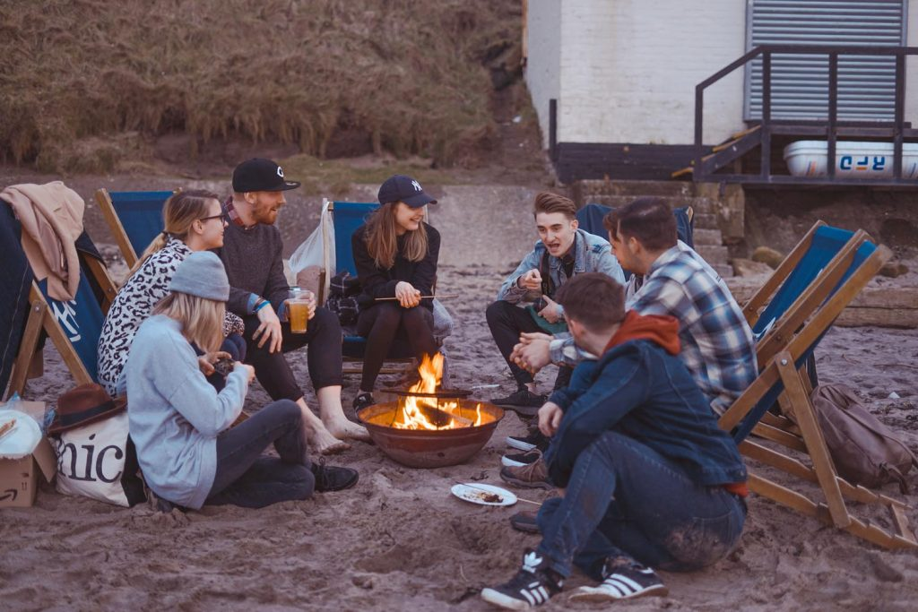 group camping around the campfire