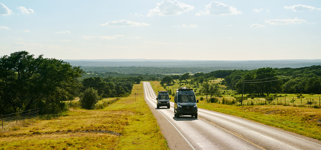 Campervans on country road