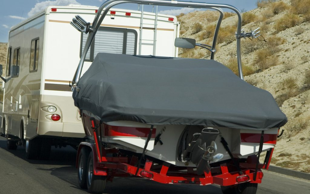 Everything You Should Know About Towing A Boat With An Rv