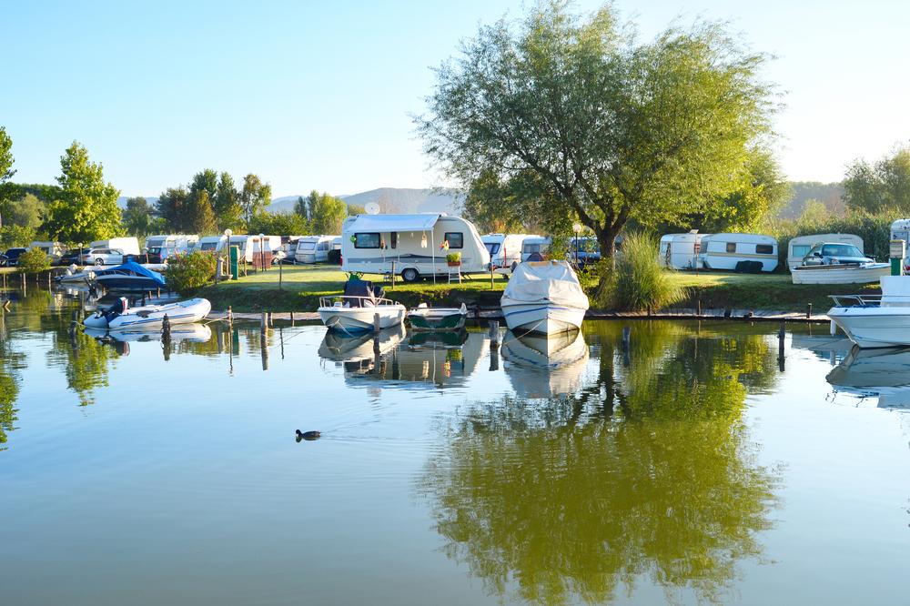 RV trailer park by a small calm lake. black water tank.