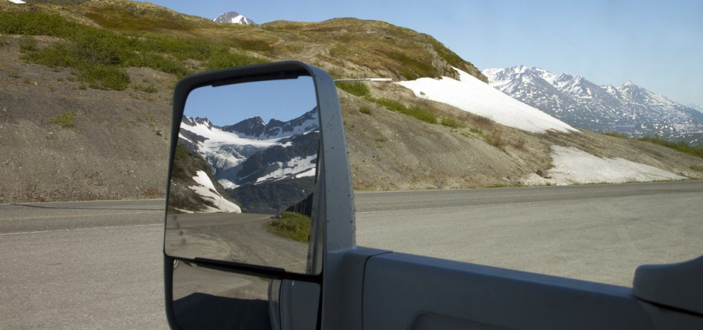 RV renters - Glacier seen from the mirror of RV