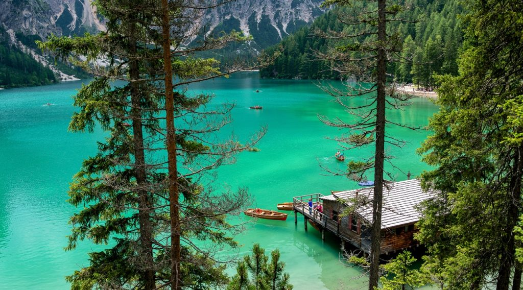 Uniquely Canadian. Turquoise waters of Lake Louise with canoes. Banff, Alberta, Canada.