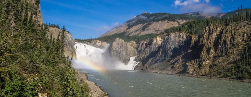 Nahanni National Park, Virginia Falls in mist and water mist rainbow at South Nahanni river, Northwest Territories, Canada
