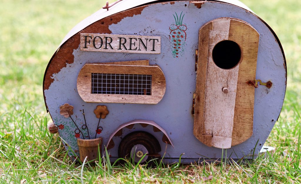 Grow your RV rental business. Miniature representation of an old travel trailer RV.