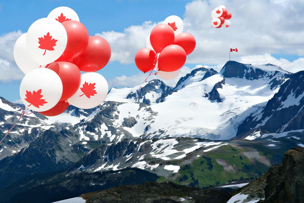 Rent an RV for Canada Day. Canadian Maple Leaf balloons float above Rocky Mountains