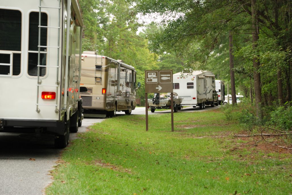 RV rental market in Canada. A line of travel trailers and motorhomes in line at campground.